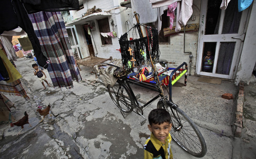 A Pakistani Christian vendor, not pictured, displays crosses on his bicycle for sale, in a Christian neighborhood in Islamabad, Pakistan, Monday, Aug. 20, 2012.  Pakistani authorities arrested a Christian girl and are investigating whether she violated the country's strict blasphemy laws after furious neighbors surrounded her house and demanded police take action, a police officer said Monday. (AP Photo/Muhammed Muheisen)