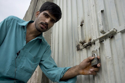 Mukhtar Khan, neighbor of an arrested Christian girl, shows the locked house of a girl in a suburb of Islamabad, Pakistan, on Monday, Aug. 20, 2012. Pakistani authorities arrested a Christian girl and are investigating whether she violated the country's strict blasphemy laws after furious neighbors surrounded her house and demanded police take action, a police officer said Monday. The arrest of the girl and outrage among the local community demonstrates the deep emotion that suspected blasphemy cases can evoke in this conservative Muslim country, where rising extremism often means religious minorities live in fear of persecution. (AP Photo/B.K. Bangash)