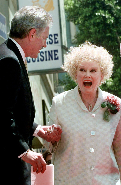 FILE-In this May 17, 1999 file photo, Emmy award winning game show host, Alex Trebek greets actress and comedian Phyllis Diller before receiving his newly-dedicated star on the Hollywood Walk of Fame in the Hollywood section of Los Angeles. Diller, the housewife turned humorist who aimed some of her sharpest barbs at herself, died Monday, Aug. 20, 2012, at age 95 in Los Angeles. (AP Photo/Nick Ut, File)