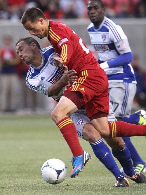 Rick Egan  | The Salt Lake Tribune   Real Salt Lake's Luis Gil (21) collides with Fabian Castillo, Dallas (7), in MLS soccer action, Real Salt Lake vs FC Dallas, in Sandy, Saturday, May 26, 2012.