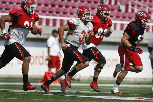 Scott Sommerdorf  |  The Salt Lake Tribune              QB Jordan Wynn and other Utes run wind sprints at the end of Utah football practice, Saturday, August 18, 2012. This was the third practice in a row that Wynn was held out of throwing the football.