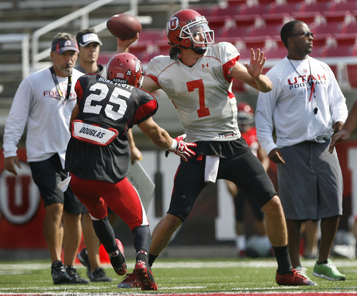 Scott Sommerdorf  |  The Salt Lake Tribune              QB Travis Wilson readies to throw while rushed by DB Mike Honeycutt at Utah football practice, Saturday, August 18, 2012. Head coach Kyle Whittingham is at left, and offensive coordinator Brian Johnson at right.