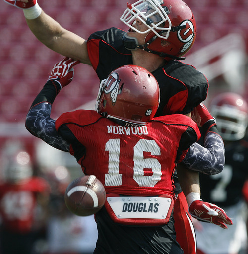 Scott Sommerdorf  |  The Salt Lake Tribune              DB Mike Honeycutt knocks away this pass intended for WR Geoff Norwood during Utah football practice, Saturday, August 18, 2012.