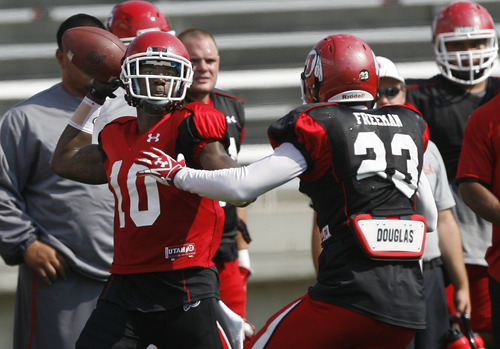 Scott Sommerdorf  |  The Salt Lake Tribune              WR DeVonte Christopher looks to pass on an option play at Utah football practice, Saturday, August 18, 2012.
