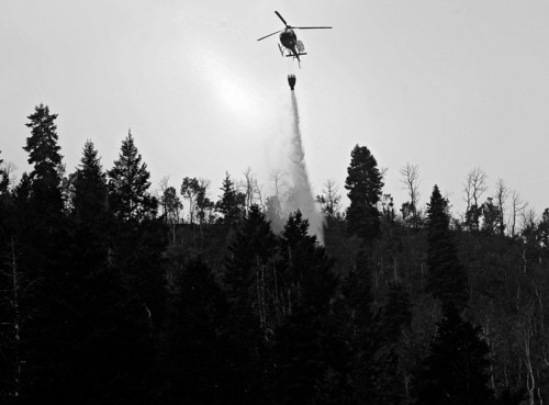 Al Hartmann  |  The Salt Lake Tribune Helicopter makes water drop on the Whiskey fire in Daniel's Canyon east of Heber and just south of U.S Highway 40 Monday August 20.