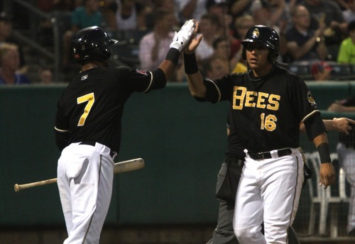 Rick Egan  | The Salt Lake Tribune    Salt Lake Bees Luis Jimenez (7) high-five's Efron Navarro (16), as he scores the go ahead run in the 5th inning for the Bees,  in baseball action, Salt Lake Bees, v.s. the Colorado Springs, Skysox, Monday, August 20, 2012.