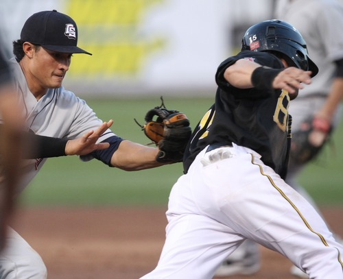 Rick Egan  | The Salt Lake Tribune    Tommy Field, Sky Sox, tags out  Matt Long, as he attempts to steal second base, in baseball action, Salt Lake Bees, v.s. the Colorado Springs, Sky Sox, Monday, August 20, 2012.