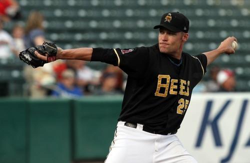 Rick Egan  | The Salt Lake Tribune    Salt Lake's starting pitcher, Greg Smith, throws for the Bees  in baseball action, Salt Lake Bees, v.s. the Colorado Springs, Sky Sox, Monday, August 20, 2012.