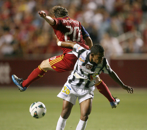 Steve Griffin | The Salt Lake Tribune   Real Salt Lake's Ned Grabavoy, back, gets tangled with Tauro FC's Rolando Botello during their Champions League game at Rio Tinto Stadium in Sandy on Tuesday, Aug. 21, 2012.