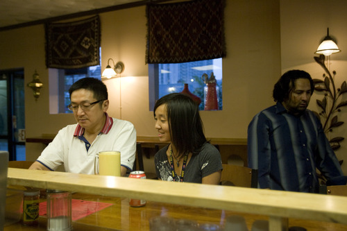 Kim Raff | The Salt Lake Tribune Francis Lau (left) and his daughter Amanda Lau eat at Salt Lake City's Curry Fried Chicken on Aug. 19, 2012.