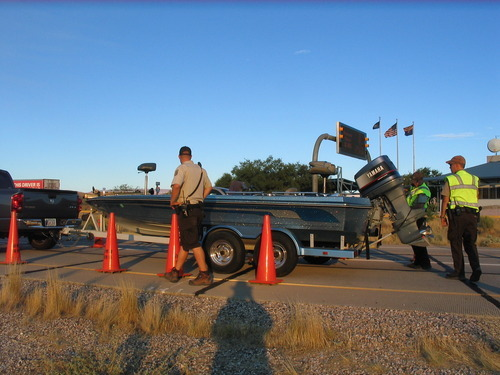 Division of Wildlife Resources employees inspect and decontaminate boats coming into the St. George Port of Entry.   Courtesy Utah Division of Wildlife Resources