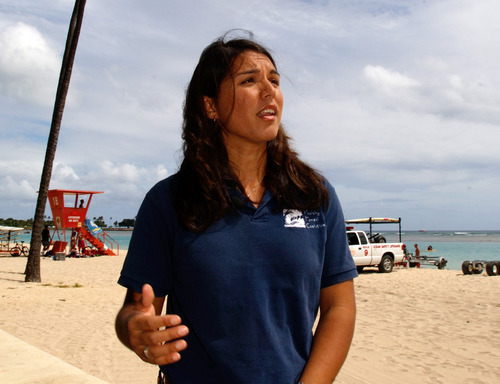 Tulsi Gabbard is seen in April 2006 on a beach near Waikiki in Honolulu. After more than a decade of wars in Iraq and Afghanistan, dozens of military veterans - Republicans and Democrats - are running for Congress this election year as voters have shown a fresh enthusiasm for candidates with no elected experience. This year, as the military has opened more jobs to women closer to the front lines, several of those veterans are females with battlefield scars and pioneering accomplishments.  (AP file photo)