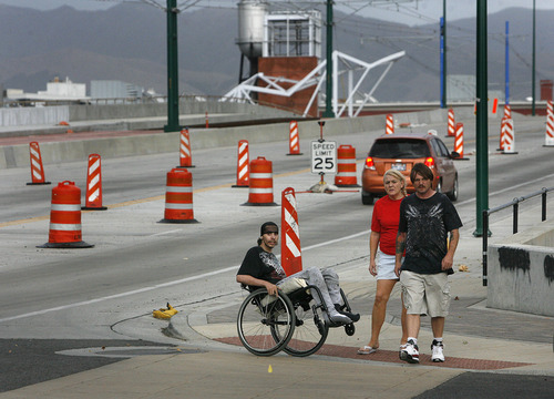 Scott Sommerdorf  |  The Salt Lake Tribune              Pedestrians prepare to cross 600 W near the new North Temple Viaduct,  Friday, August 11, 2012.   Barbara Brown, an environmental psychologist with the University of Utah Department of Family and Consumer Studies, is leading research to determine whether walkable neighborhoods impact health. She will rig hundreds of participants who live near North Temple with devices that will monitor their movements now and a year later after North Temple project has been completed and the place becomes a pedestrian's paradise.