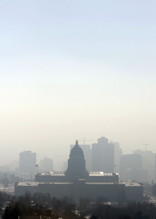 Francisco Kjolseth | Tribune file photo A nasty swill of pollution obscures the Salt Lake City skyline beyond the Capitol in 2009. The state's new asthma action plan emphasizes limiting exposure to pollution. It doesn't mention reducing pollution.