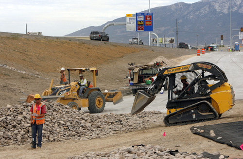 Francisco Kjolseth  |  The Salt Lake Tribune Construction moves along the I-15 CORE project as crews work to finish up the Orem Center Street exit on Wednesday. Gov. Gary Herbert went on a tour of the Utah County project that spans 26 miles from Lehi to Spanish Fork and is 90 percent complete. The $1.7 billion project is expected to be completed by the holidays.