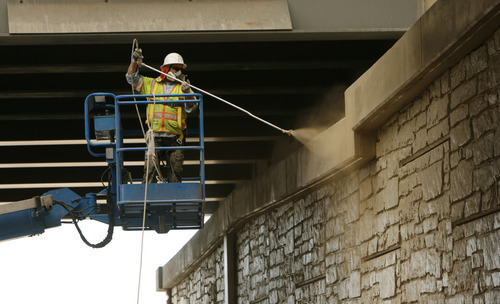 Francisco Kjolseth  |  The Salt Lake Tribune David Granados paints the underside of the I-15 bridge at the Orem Center street exit on Wednesday. The $1.7 billion project is expected to be completed by the holidays.