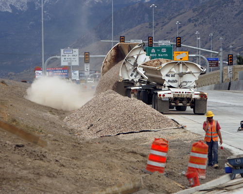 Francisco Kjolseth  |  The Salt Lake Tribune Construction moves along the I-15 CORE project as crews work to finish up the Orem Center Street exit on Wednesday. The massive highway rebuild project through Utah County will weigh in at $1.7 billion -- some $230 million under budget.