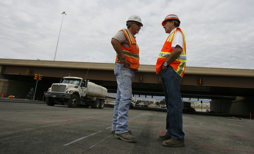 Francisco Kjolseth  |  The Salt Lake Tribune Gov. Gary Herbert speaks with Jack Chruma during a tour of the I-15 CORE project in Orem on Wednesday.