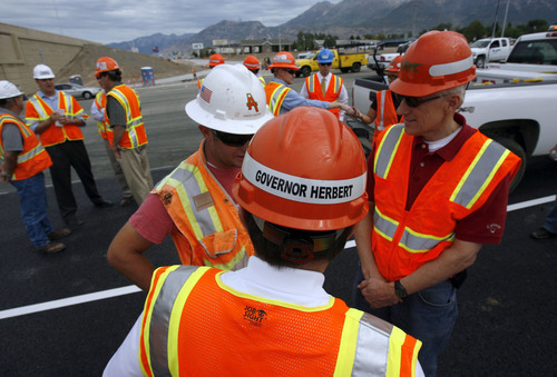 Francisco Kjolseth  |  The Salt Lake Tribune Gov. Gary Herbert and Lt. Gov. Greg Bell, right, speak with Jason Harper on the progress of the  I-15 CORE during a tour at the Orem Center Street exit on Wednesday. The governor says the state made the right decision in awarding the contract to the consortium that is delivering the project under budget and under schedule.