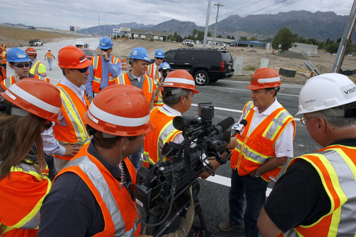 Francisco Kjolseth  |  The Salt Lake Tribune Gov. Gary Herbert, second from right, speaks with the media during a tour of the I-15 CORE project on Wednesday. The massive $1.7 billion project is 90 percent complete.