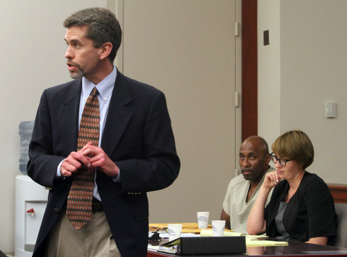 Rick Egan  | The Salt Lake Tribune   Defense attorney Michael Sikora, questions a witness, as Thomas Pennington (center) and attorney Mariam Larson listen to the proceedings, during Pennington's preliminary hearing in Judge Robin Reese's court room, at the Matheson Courthouse, in Salt Lake City, Thursday, August 23, 2012.  Pennington is charged in the 1986 cold-case murder of Patricia Ramirez. He is charged with one count of murder in the second degree, a first-degree felony.