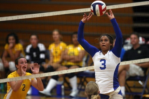 Kim Raff | The Salt Lake Tribune (right) Bingham player Nakisha Willden sets the ball at the net against Taylorsville in Taylorsville,Utah on August 22, 2012.
