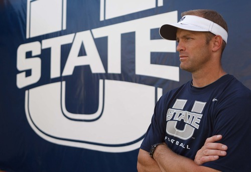 Trent Nelson  |  The Salt Lake Tribune Utah State University's new offensive coordinator Matt Wells in Romney Stadium in Logan, Utah Wednesday, August 22, 2012.