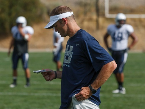 Trent Nelson  |  The Salt Lake Tribune Utah State University's new offensive coordinator Matt Wells at football practice in Logan, Utah Wednesday, August 22, 2012.