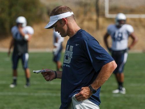 Trent Nelson  |  The Salt Lake Tribune Utah State University's new offensive coordinator Matt Wells at football practice in Logan, Utah Wednesday, August 22, 2012.