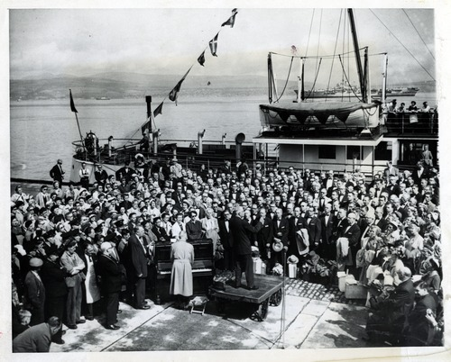 Tribune file photo  The original caption on this photo from August 19, 1955, says: The mixed choir from the Mormon Tabernacle from Salt Lake City, Utah, 397-strong and accompanied by 400 supporters, are shown on a dock at Greenook, Scotland, Aug. 19. This appearance is the start of their European tour, which is the first they have made outside of the United States. The choir will tour Britain and seven European countries before returning home by the way of Paris, Sept. 18. Dr. J. Spencer Cornwall conducts the choir.