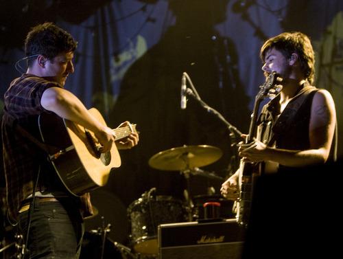 Kim Raff | The Salt Lake Tribune Mumford & Sons' Marcus Mumford, left, and Country Winston Marshall perform at Saltair in Magna on Aug. 22, 2012.