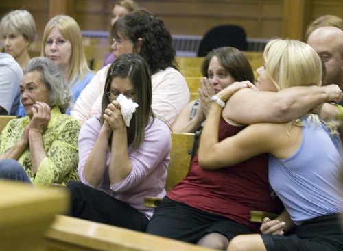 Family of victim Micaela Costanzo react during Kody Cree Patten's sentencing, Friday, Aug. 24, 2012, in Elko District Court, Elko, Nev. Patten, who pleaded guilty to first-degree murder in the 2011 killing of a West Wendover High School classmate, was sentenced to  life in prison without the possibility of parole. (AP Photo/Elko Daily Free Press, Ross Andreson)