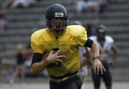 Kim Raff | The Salt Lake Tribune Cottonwood High School starting quarterback Cooper Bateman runs a play during a football scrimmage at Cottonwood High School in Murray, Utah on August 10, 2012.