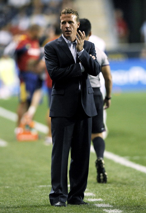 Philadelphia Union coach John Hackworth talks to his players on the bench during the second half of an MLS soccer game against Real Salt Lake on Friday, Aug. 24, 2012, in Chester, Pa. The game ended in a 0-0 tie. (AP Photo/Michael Perez)