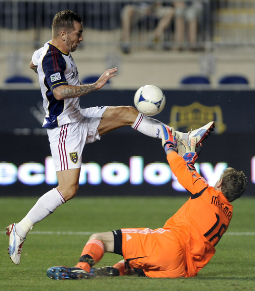 Philadelphia Union's Zac MacMath (18) blocks a shot from Real Salt Lake's Jonny Steele (22), of Northern Ireland, during the second half of an MLS soccer game on Friday, Aug. 24, 2012, in Chester, Pa. The game ended in a 0-0 tie. (AP Photo/Michael Perez)