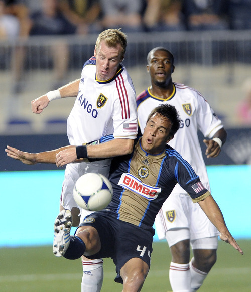 Philadelphia Union's Danny Cruz, right, shoots on goal in front of Real Salt Lake's Nat Borchers, left, during the first half of an MLS soccer game on Friday, Aug. 24, 2012, in Chester, Pa.  (AP Photo/Michael Perez)