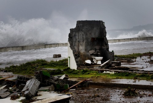 A home that was built twice within the last two years is left in ruins during the passage of Tropical Storm Isaac near the seawall in Baracoa, Cuba, Saturday, Aug. 25, 2012. Tropical Storm Isaac pushed into Cuba on Saturday after sweeping across Haiti's southern peninsula. Isaac's center made landfall just before midday near the far-eastern tip of Cuba. (AP Photo/Ramon Espinosa)