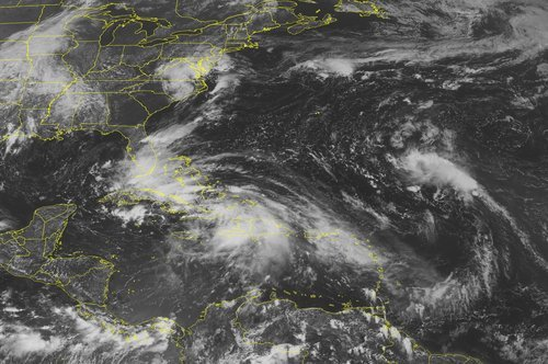 This NOAA satellite image taken Saturday, August 25, 2012 at 1:45 PM EDT shows Tropical Storm Isaac located about 40 miles north of Guantanamo, Cuba.  The system has maximum winds up to 60 mph and moves northwestward at 17 mph.  A Hurricane Warning remains in effect for the Florida Keys and the west coast of Florida.  A Hurricane Watch is in effect for Haiti, the east coast of Florida and the Bahamas.  Tropical storm warnings and watches remain in effect for the rest of the northern Caribbean Islands. Isaac currently brings torrential rains to Hispaniola with rainfall accumulations exceeding 10 inches in some areas. This system is expected to bring heavy rains into southern Florida starting Sunday afternoon and evening. (AP PHOTO/WEATHER UNDERGROUND)