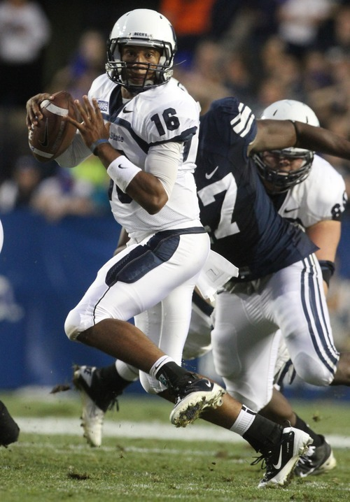 Rick Egan  | The Salt Lake Tribune   Utah State Aggies quarterback Chuckie Keeton (16) looks for a receiver for the Aggies in football action, BYU vs Utah State,  in Provo, Friday, September 30, 2011.