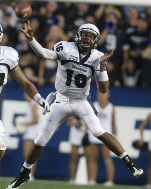 Rick Egan  | The Salt Lake Tribune   Utah State Aggies quarterback Chuckie Keeton (16) throws down field, in football action, BYU vs Utah State,  in Provo, Friday, September 30, 2011.