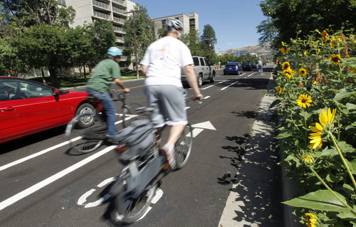 Al Hartmann  |   The Salt Lake Tribune Bicyclists ride along Salt Lake City's separated bikeway along 300 East and 700 South.  It's the first in the state.