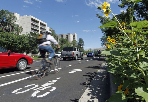 Al Hartmann  |   The Salt Lake Tribune A bicyclist rides along Salt Lake City's separated bikeway along 300 East and 700 South.  It's the first in the state.