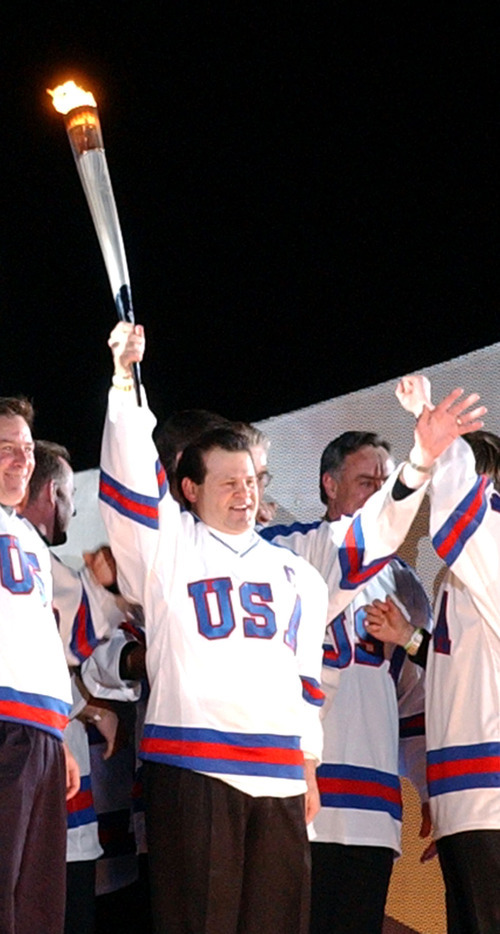 Danny La | Tribune file photo Mike Eruzione, the captain of the 1980 U.S. Olympic hockey team, holds aloft a torch before lighting the Olympic cauldron during the 2002 Winter Games Opening Ceremony at Rice-Eccles Stadium. He will be among the Olympians appearing at the 2012 GOP Convention.