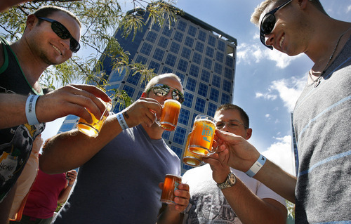 Scott Sommerdorf  |  The Salt Lake Tribune              Mike Paap, left, Ian Gustaveson, Ryan Reid and Ryan Ring enjoy beer samples at the Utah Beer Festival at the Galivan Center, Sunday, August 26, 2012. Twenty-three breweries from Utah and the region took part.