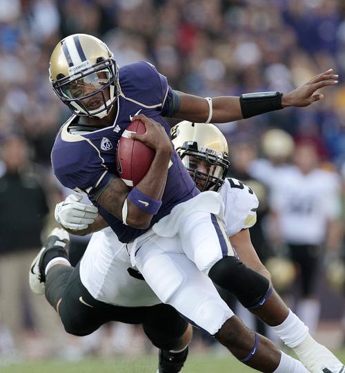 Washington quarterback Keith Price scrambles against Colorado in the first half of an NCAA college football game Saturday, Oct. 15, 2011, in Seattle. Washington won 54-24. (AP Photo/Elaine Thompson)