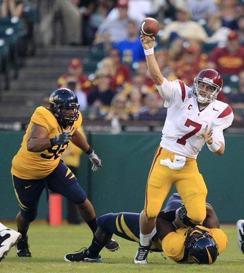 Southern California quarterback Matt Barkley (7) throws under pressure against California during the first quarter of an NCAA college football game in San Francisco, Thursday, Oct. 13, 2011. (AP Photo/Marcio Jose Sanchez)