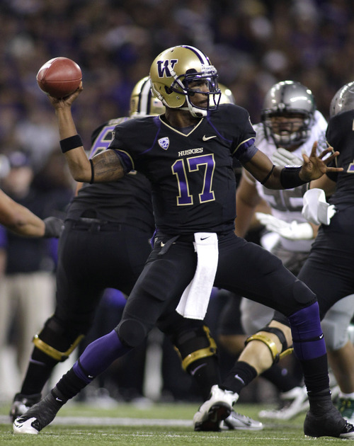 Washington quarterback Keith Price passes against Oregon in the first half of an NCAA college football game, Saturday, Nov. 5, 2011, in Seattle. (AP Photo/Ted S. Warren)
