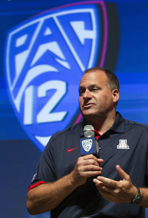 Arizona head coach Rich Rodriguez takes questions at the Pac-12 NCAA college football media day in Los Angeles, Tuesday, July 24, 2012. (AP Photo/Damian Dovarganes)