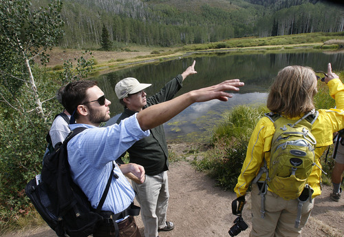 Scott Sommerdorf  |  The Salt Lake Tribune              Save Our Canyons Executive Director Carl Fisher, left, gestures to where some of the proposed SkiLink gondola poles would go along with Rep. Joel Briscoe, D-Salt Lake City, and congressional candidate Donna McAleer at Willow Lake, Saturday, August 25, 2012. SOC and other environmental groups held a press conference to denounce the SkiLink proposal and tout what they contend is growing opposition to the idea. A hike followed through the Willow Heights Trail area believed to fall under the proposed gondola.