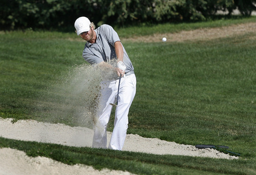 Scott Sommerdorf  |  The Salt Lake Tribune              Dusty Fielding hits his second shot from a fairway bunker on 18 at the Utah Open, Sunday, August 26, 2012. He was unable to catch Dusty Fielding who birdied 18 and won the Utah Open at 19 under.